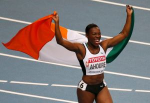 Ahoure of the Ivory Coast celebrates winning second place in the women's 100 metres final during the IAAF World Athletics Championships at the Luzhniki Stadium in Moscow